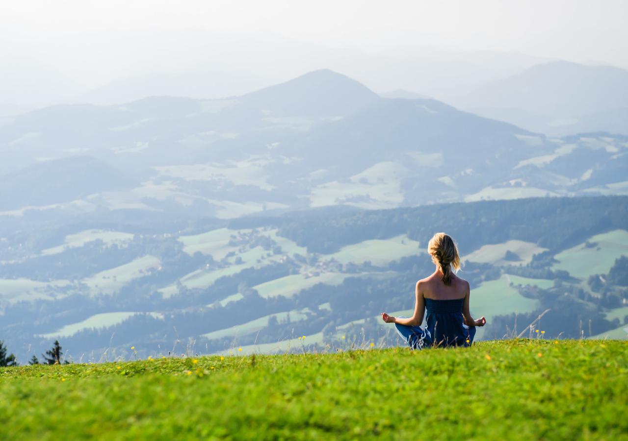 Meditating on a hillside